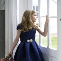 Navy satin flower girl or bridesmaid dresses by designer Nicki Macfarlane UK