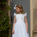 Ivory Communion Dress in a tilled embellished with pretty sparkles, silk bodice. By UK designer Nicki Macfarlane.